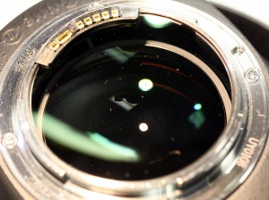 Rear element of a Canon 85mm f1.2 with Megadust