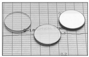 Effect of optical coatings of different efficiency. Image courtesy C. V. Melles Griot