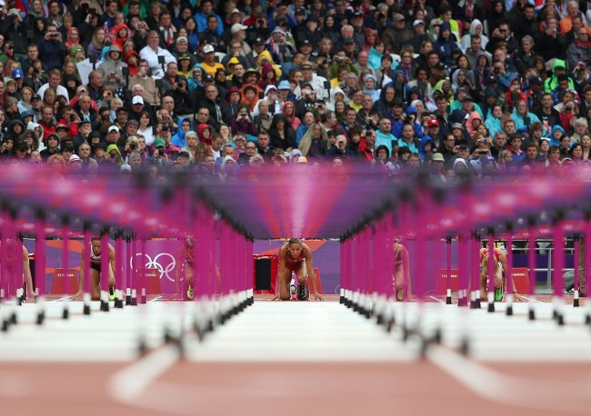 Lolo Jones prepares to run in the 100m hurdles during track and field at the Olympic Stadium during day 11 of the London Olympic Games in London, England, United Kingdom on August 7, 2012. (Jed Jacobsohn/for The New York Times)