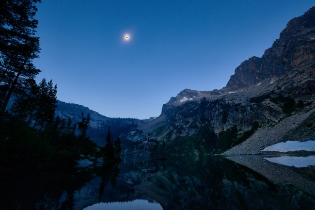 Solar Eclipse over Alpine Lake, in the Sawtooth Wilderness, Idaho
